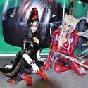 Popular Filipina cosplayers Jan Illenberger and Alodia Gosiengfiao hang out at the 2010 San Diego Comic Con. Jan cosplays Bayonetta from the video game Bayonetta. Alodia cosplays Amaha Masane from the anime series Witchblade.