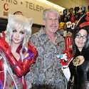 Popular Filipina cosplayers Alodia Gosiengfiao and Jan Illenberger meet Hollywood actor Ron Perlman at the 2010 San Diego Comic Con. Alodia cosplays Amaha Masane from the anime series Witchblade. Jan cosplays Bayonetta from the video game Bayonetta.