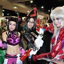 Popular Asian cosplayers Linda Le, Jan Illenberger, and Alodia Gosiengfiao pose for the cameras at the 2010 San Diego Comic-Con. Linda cosplays Juri Han from the video game Super Street Fighter IV. Jan cosplays Bayonetta from the video game Bayonetta. Alodia cosplays Amaha Masane from the anime series Witchblade.