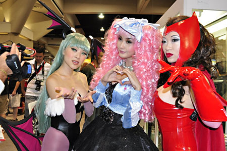 Popular Asian cosplayers Linda Le, Alodia Gosiengfiao, and Yaya Han pose for the cameras at the 2010 San Diego Comic-Con. Linda cosplays Morrigan Aensland from the video game Darkstalkers. Alodia cosplays Miwako Sakurada from the anime series Paradise Kiss. Yaya cosplays Scarlet Witch from the comic book metaseries X-Men and Avengers. Photo by Erskine Manglicmot.